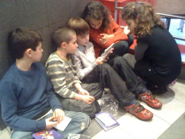 Kids huddled around a Nintendo